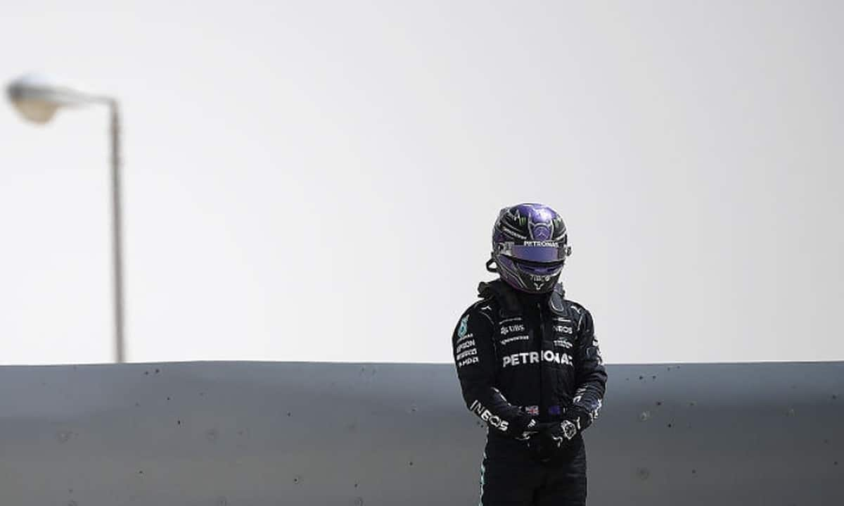 Lewis Hamilton of Great Britain driving the (44) Mercedes AMG Petronas F1 Team Mercedes W12 looks on after ending up in a gravel trap during Day Two of F1 Testing at Bahrain International Circuit on March 13, 2021 in Bahrain, Bahrain. (Photo by Clive Mason/Getty Images)