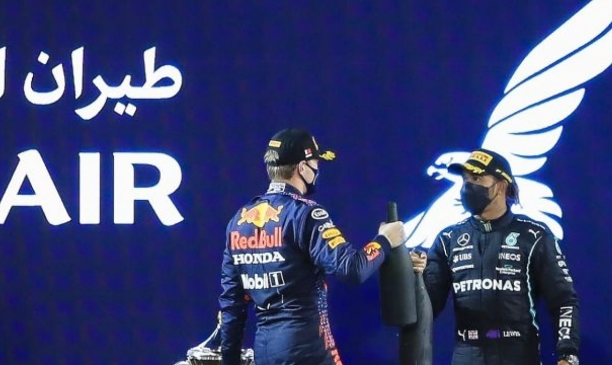 Red Bull's Dutch driver Max Verstappen greets Mercedes' British driver Lewis Hamilton on the podium after the Bahrain Formula One Grand Prix at the Bahrain International Circuit in Sakhir on March 28, 2021. (Photo by Ayman Yaqoob/Anadolu Agency via Getty Images)