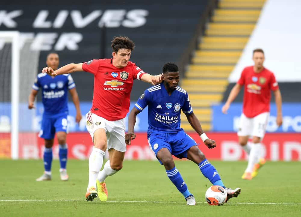 Kelechi Iheanacho of Leicester City is challenged by Harry Maguire of Manchester United during the Premier League match between Leicester City and Manchester United at The King Power Stadium on July 26, 2020 in Leicester, England.Football Stadiums around Europe remain empty due to the Coronavirus Pandemic as Government social distancing laws prohibit fans inside venues resulting in all fixtures being played behind closed doors.