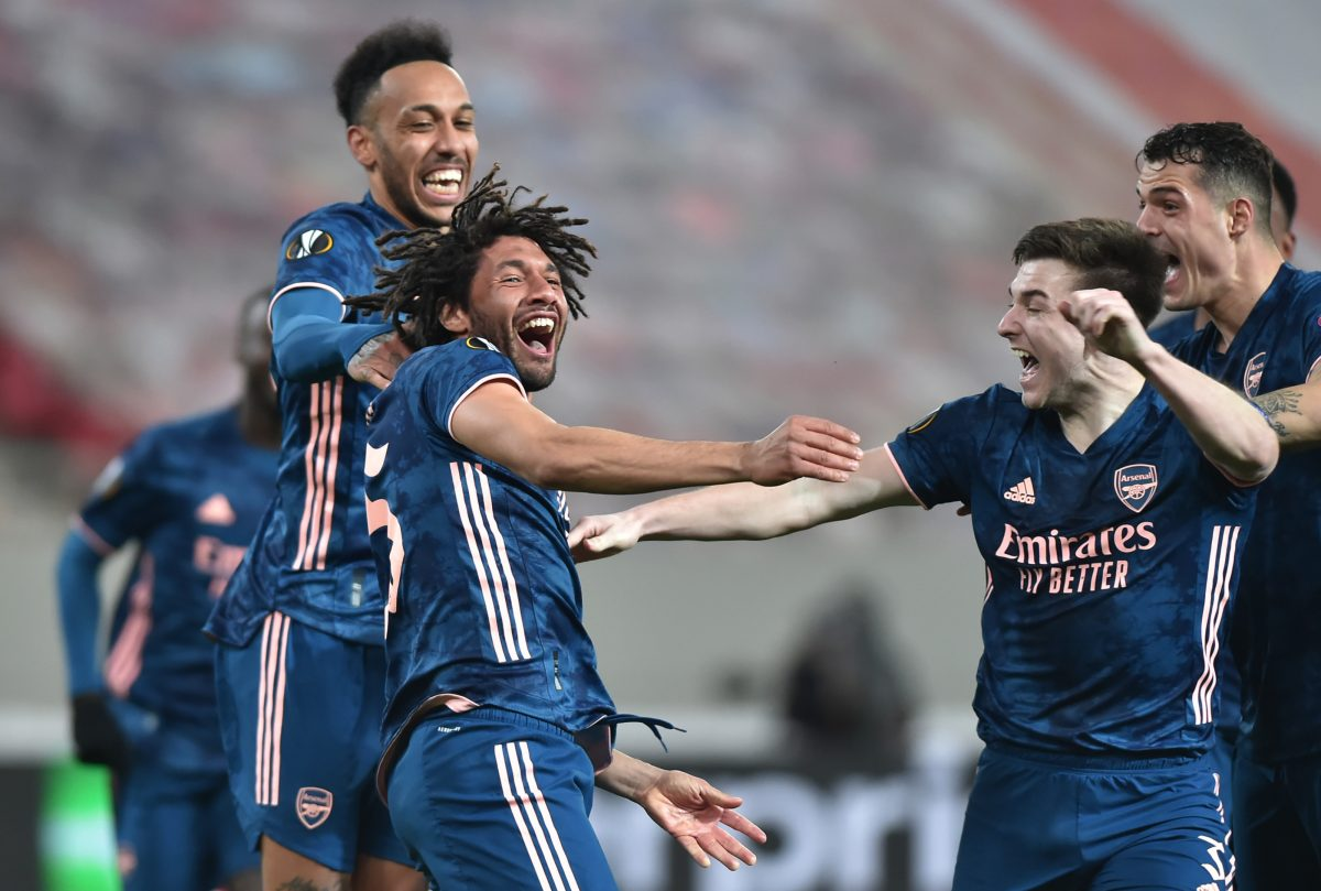 Mohamed Elneny of Arsenal celebrates with team mates Kieran Tierney and Pierre-Emerick Aubameyang after scoring their side's third goal during the UEFA Europa League Round of 16 First Leg match between Olympiacos and Arsenal at Karaiskakis Stadium on March 11, 2021 in Piraeus, Greece. Sporting stadiums around Europe remain under strict restrictions due to the Coronavirus Pandemic as Government social distancing laws prohibit fans inside venues resulting in games being played behind closed doors.