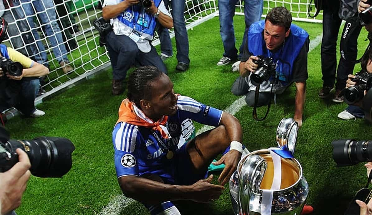 Didier Drogba of Chelsea celebrates with the trophy surrounded by photographers after their victory in the UEFA Champions League Final between FC Bayern Muenchen and Chelsea at the Fussball Arena München on May 19, 2012 in Munich, Germany. (Photo by Alex Livesey/Getty Images)