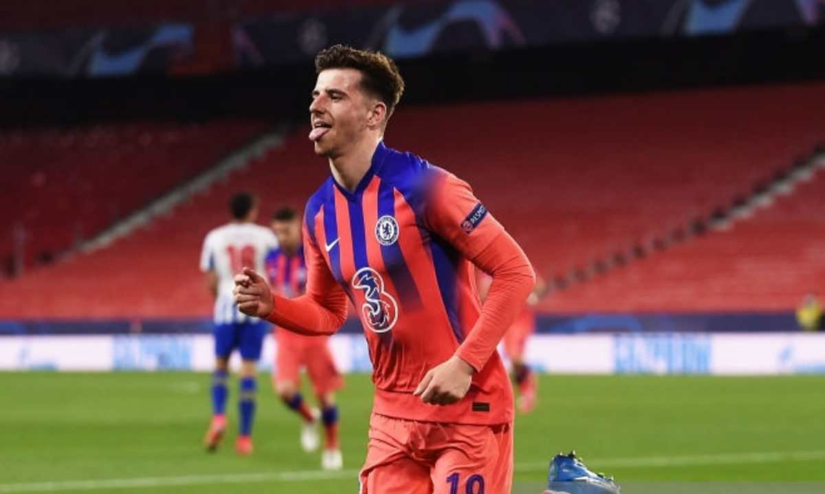 Mason Mount of Chelsea celebrates after scoring their side's first goal during the UEFA Champions League Quarter Final match between FC Porto and Chelsea FC at Estadio Ramon Sanchez Pizjuan on April 07, 2021 in Seville, Spain. Sporting stadiums around Spain remain under strict restrictions due to the Coronavirus Pandemic as Government social distancing laws prohibit fans inside venues resulting in games being played behind closed doors. (Photo by Denis Doyle - UEFA/UEFA via Getty Images)