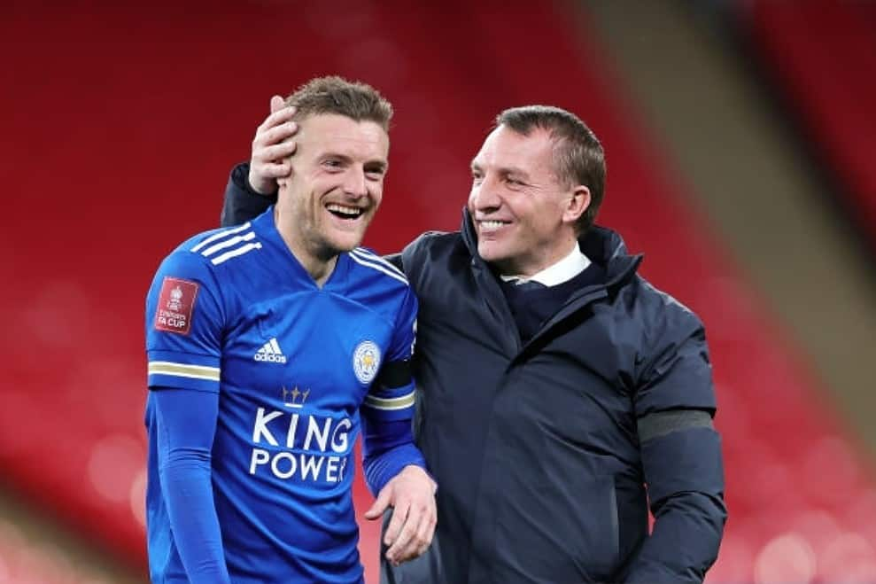 Leicester City Manager Brendan Rodgers celebrates with Jamie Vardy of Leicester City after the Semi Final of the Emirates FA Cup match between Leicester City and Southampton FC at Wembley Stadium on April 18, 2021 in London, England. 4000 local residents have been permitted to attend the match as part of the government's Events Research Programme, which will study how to safely hold major events once coronavirus lockdown measures are eased. Other sporting events around the United Kingdom continue to be played behind closed doors. (Photo by Plumb Images/Leicester City FC via Getty Images)