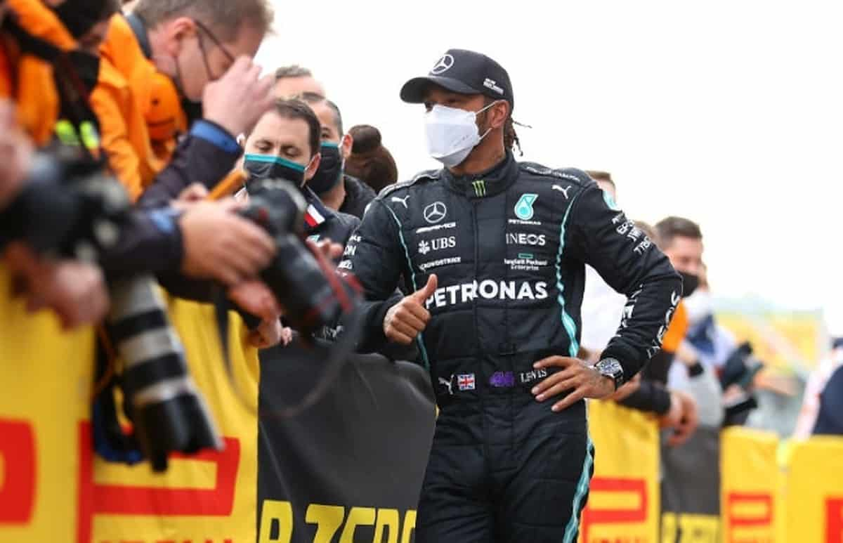 Second placed Lewis Hamilton of Great Britain and Mercedes GP talks with team members in parc ferme after the F1 Grand Prix of Emilia Romagna at Autodromo Enzo e Dino Ferrari on April 18, 2021 in Imola, Italy. (Photo by Bryn Lennon/Getty Images)