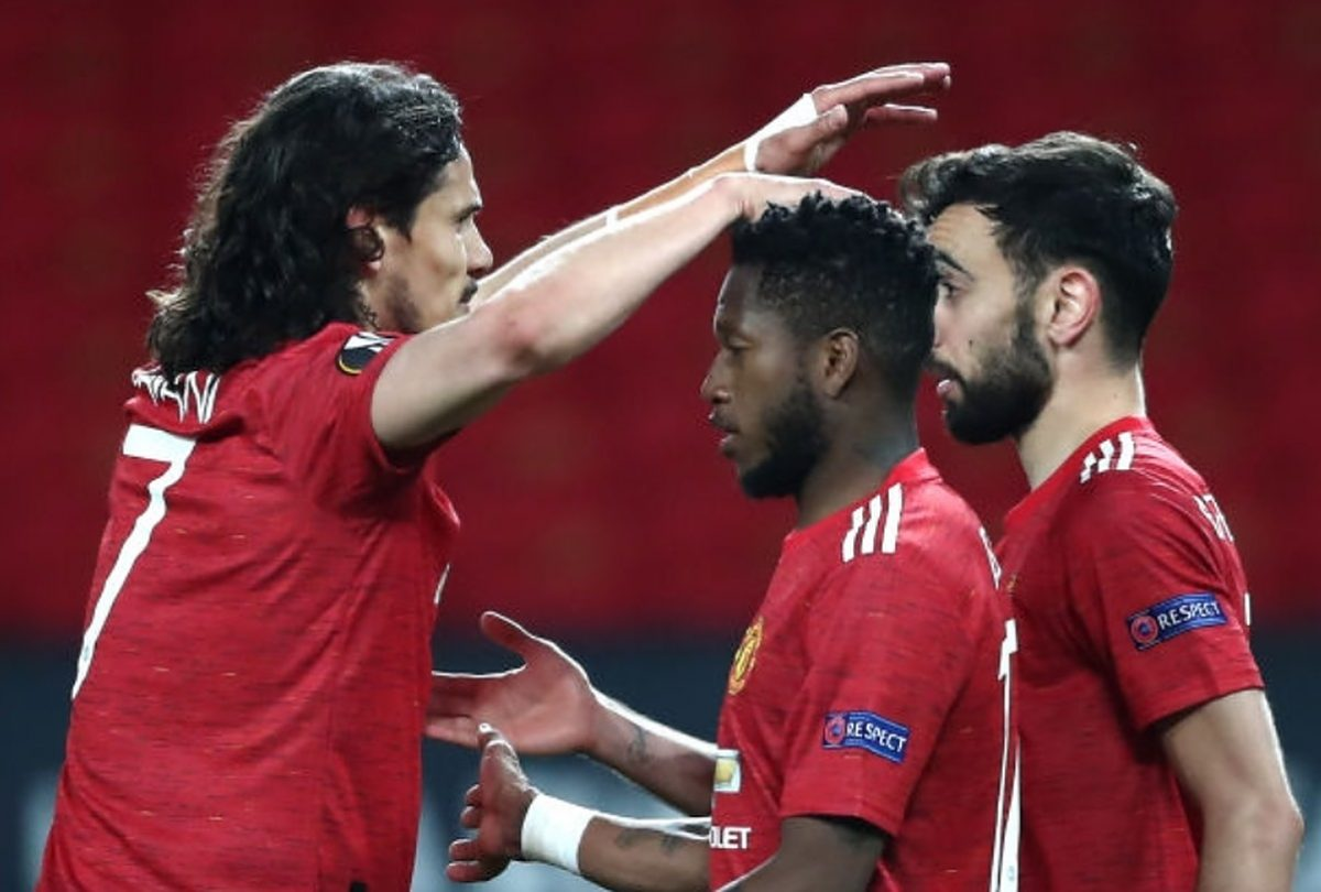 Bruno Fernandes of Manchester United celebrates after scoring their team's fourth goal with teammate Edinson Cavani during the UEFA Europa League Semi-final First Leg match between Manchester United and AS Roma at Old Trafford on April 29, 2021 in Manchester, England. Sporting stadiums around Europe remain under strict restrictions due to the Coronavirus Pandemic as Government social distancing laws prohibit fans inside venues resulting in games being played behind closed doors. (Photo by Jan Kruger - UEFA/UEFA via Getty Images)