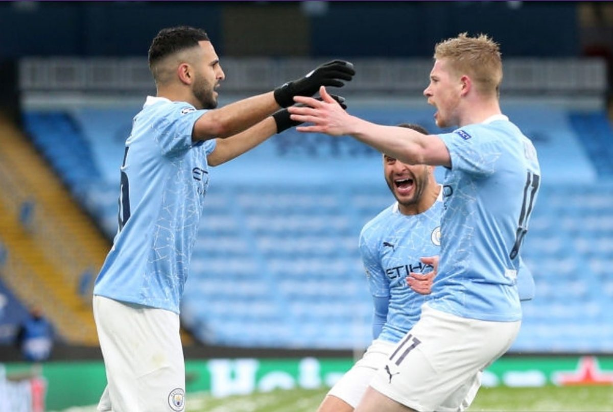 Riyad Mahrez of Manchester City celebrates with Kevin De Bruyne and Kyle Walker after scoring his team's first goal during the UEFA Champions League Semi Final Second Leg match between Manchester City and Paris Saint-Germain at Etihad Stadium on May 04, 2021 in Manchester, England. Sporting stadiums around the UK remain under strict restrictions due to the Coronavirus Pandemic as Government social distancing laws prohibit fans inside venues resulting in games being played behind closed doors. (Photo by Victoria Haydn/Manchester City FC via Getty Images)