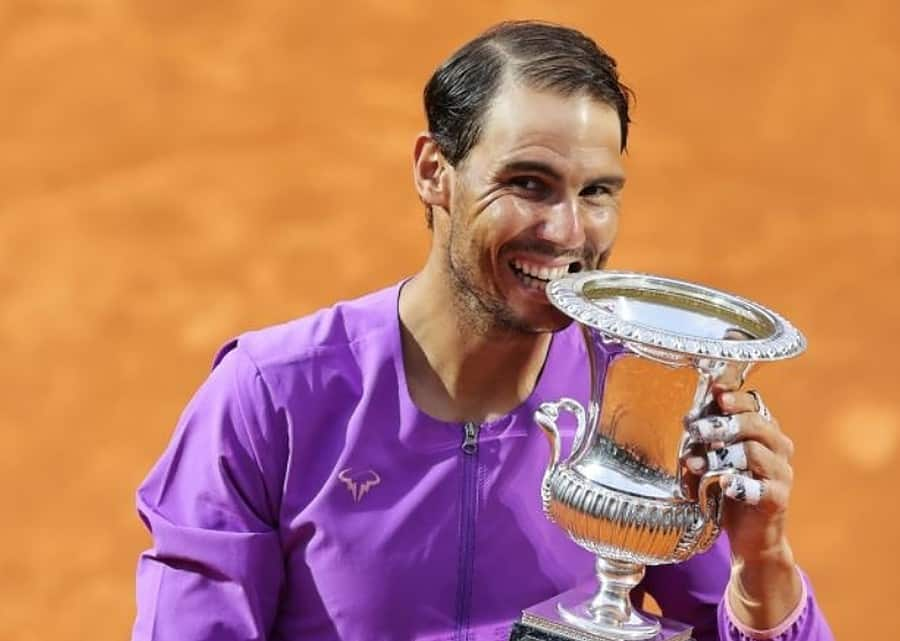Rafael Nadal of Spain celebrates with the trophy after winning the final over Novak Djokovic of Serbia during the men's final at Foro Italico on May 16, 2021 in Rome, Italy. (Photo by Clive Brunskill/Getty Images)