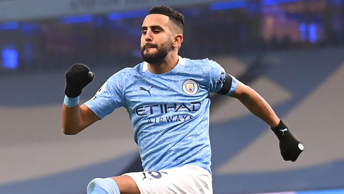 Riyad Mahrez of Manchester City celebrates after scoring his team's first goal during the Premier League match between Manchester City and Burnley at Etihad Stadium on November 28, 2020 in Manchester, England. Sporting stadiums around the UK remain under strict restrictions due to the Coronavirus Pandemic as Government social distancing laws prohibit fans inside venues resulting in games being played behind closed doors. (Photo by Laurence Griffiths/Getty Images)