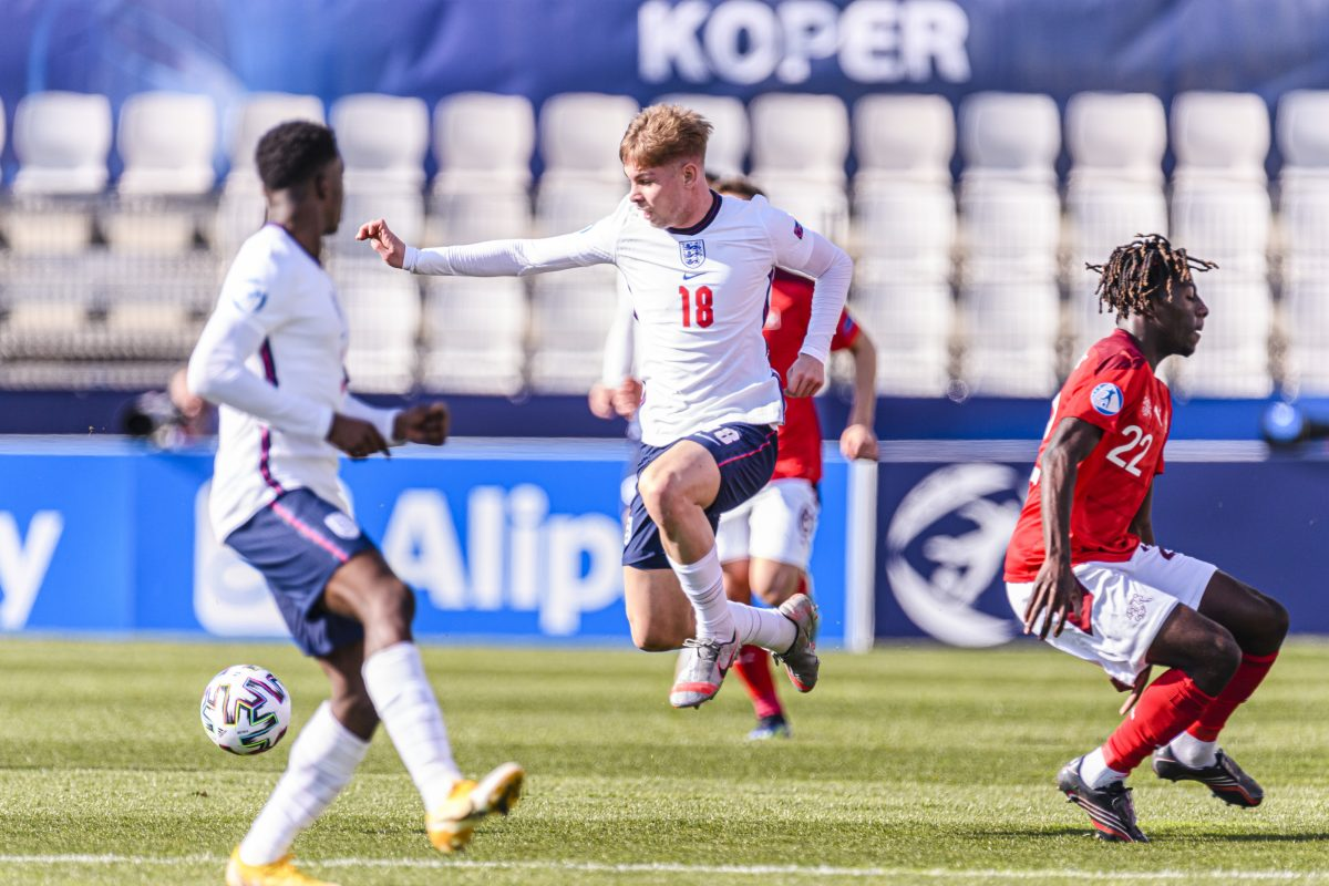 Emile Smith Rowe of England (L) dribbles past Alexandre Jankewitz of Switzerland (R) during the 2021 UEFA European Under-21 Championship Group D match between England and Switzerland at Stadion Bonifika on March 25, 2021 in Koper, Slovenia. (Photo by Marcio Machado/Getty Images)